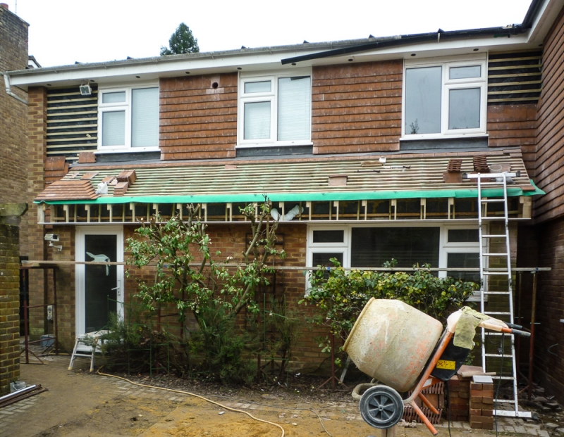 Week 12 Day 2 - work continues replacing flat roof & panelling